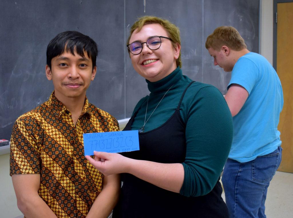 Field Methods student with Sundanese script nametag